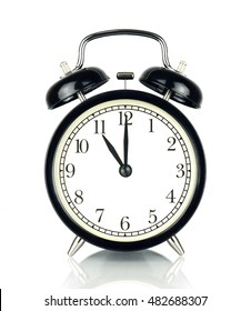 Alarm Clock isolated on white, in black and white, showing eleven o'clock.
