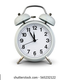 Alarm clock isolated on white with clipping path, five minutes to twelve