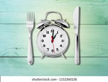Alarm clock with knife and fork
