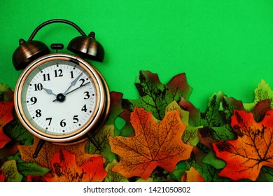 Alarm clock with Maple leaf boder on green background