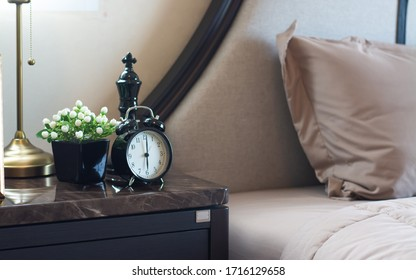 Alarm clock in modern bedroom design.