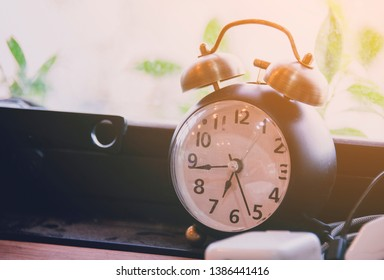 Alarm clock in morning time with vintage style