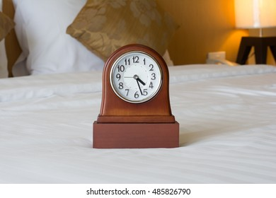 alarm clock on the bed