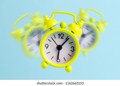 Alarm clock on a blue background. Early awakening, good morning