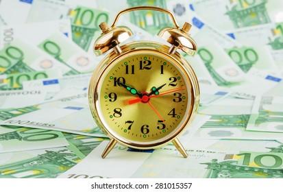 Alarm clock on a Euro banknotes