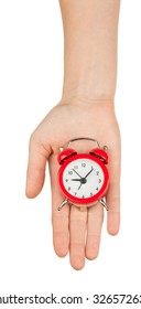 Alarm clock on humans hand on isolated white background