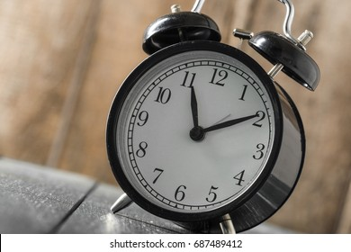 Alarm clock on an old wooden table