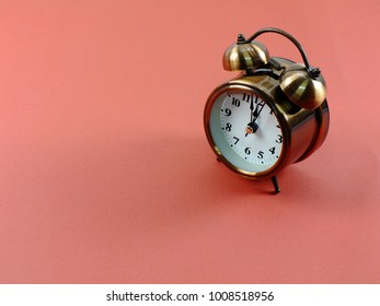 alarm clock on pink background with space for copy background