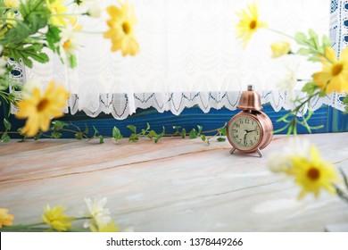 An alarm clock on the table.