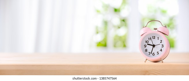 Alarm clock on table by the window