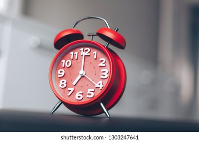 Alarm clock on table in living room close-up