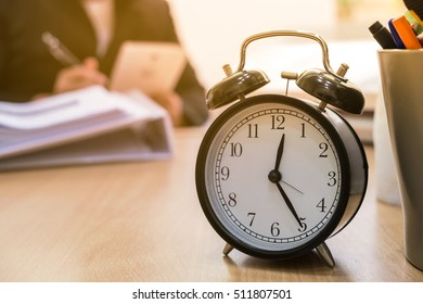 alarm clock on the table in office, business time concept
