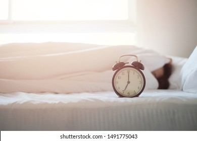 Alarm clock on white background with copy space for you design.