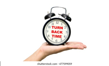 Alarm clock on white background with a word turn back time. - Shutterstock ID 477599059