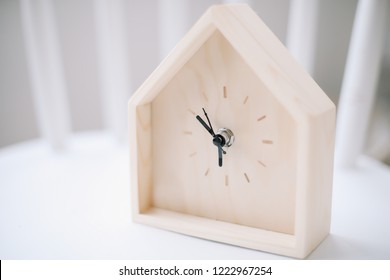 alarm clock on white wooden background. Time of day