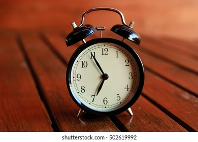 Alarm clock on a wooden tale