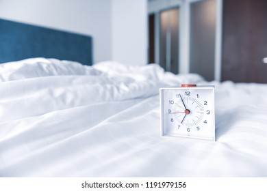 Alarm clock place on a bed