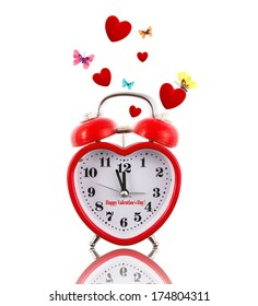 Alarm clock ringing with hearts and butterflies all around