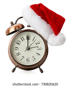 alarm clock with santa hat isolated on a white background