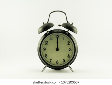 alarm clock show 12 o'clock isolated on white background