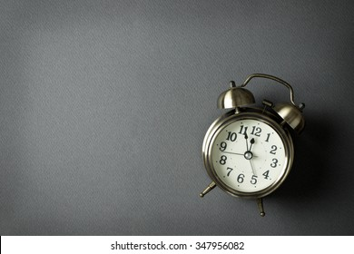 Alarm clock showing almost 12 o clock, with copy space
