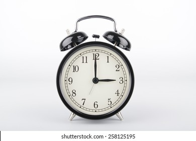 Alarm clock is showing the right time. Three o'clock.