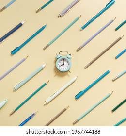 Alarm clock shows 8 oclock in morning, time to go to school concept. Creative layout with clock and stationary school supplies in yellow and blue  pastel colored.