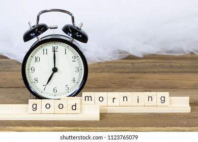 Alarm clock to sound at 7 o'clock