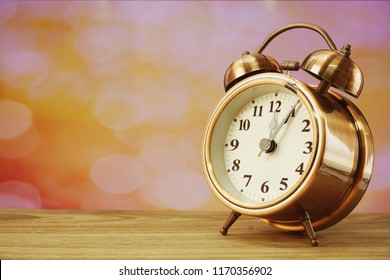 alarm clock with space for copy on wooden background