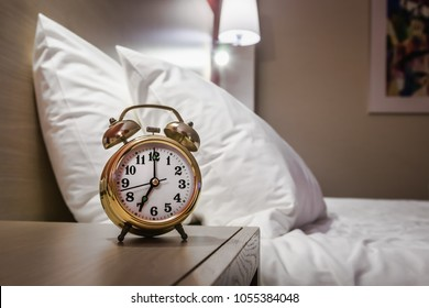 alarm clock stands on a bedside table in the room or hotel room