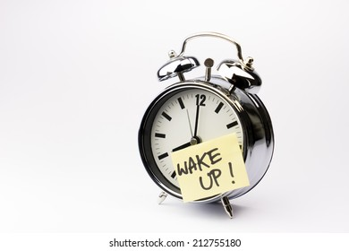 Alarm clock with sticky paper note on white background