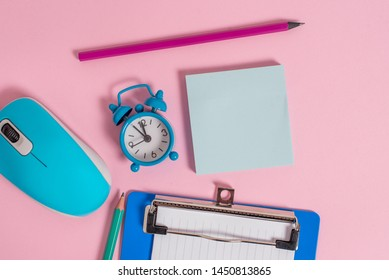 Alarm clock wakeup clipboard paper sheets notepad markers mouse hardware colored background Empty text important events what to do home house school office college