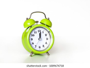 Alarm clock, watch hands at midnight or noon