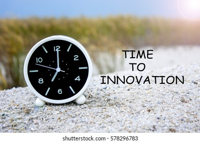 alarm clock with word time to innovation concepts isolated on grass tree background
