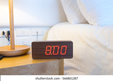 Alarm clock work time on the bed 8 am.