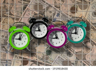 Alarm clocks as a tax reminder symbol. Bars as a symbol of prison for unpaid tax on time or hiding income from the Tax Office.