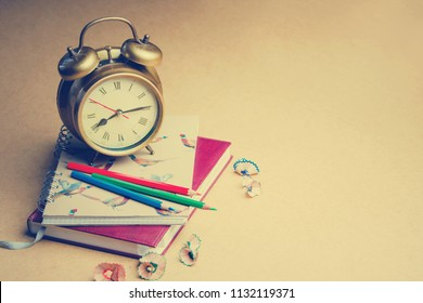 Alarm clock,schoolchild and student studies accessories. Back to school concept.