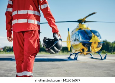 Alarm for helicopter emergency medical service. Paramedic running to helicopter on heliport. Themes rescue, help and hope.