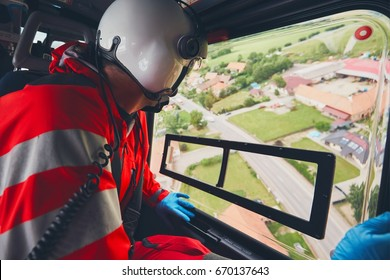 Alarm for helicopter emergency medical service. Doctor looking from window on the road. Theme rescue, help and hope.