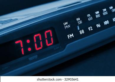 Alarm radio clock indicating time to wake up