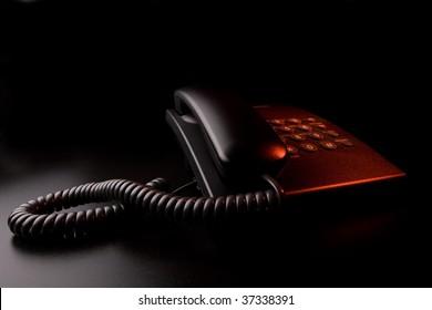 Alarm signal - phone under red light in the dark
