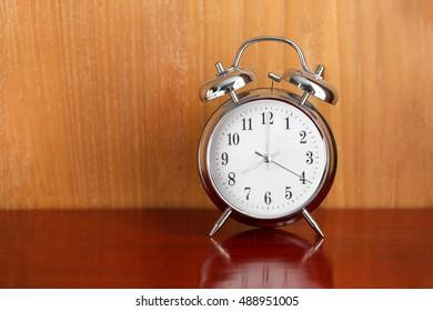 alarm table clock on wood table