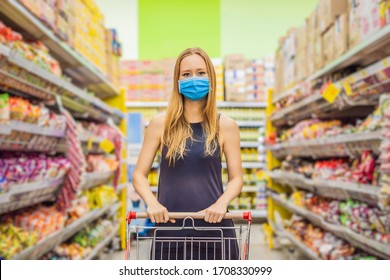 Alarmed female wears medical mask against coronavirus while grocery shopping in supermarket or store- health, safety and pandemic concept - young woman wearing protective mask and stockpiling food