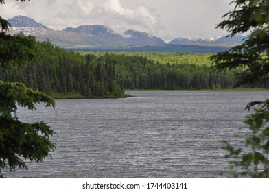 Alaska lakes, trees and mountains in the distance