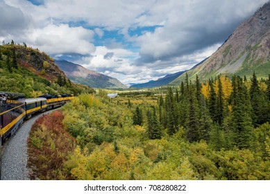 Alaska railroad traveling through beautiful autumn landscape and mountains