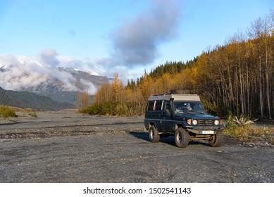 Alaska, Resurrection River Bed - September 26, 2017. Offroad Car parked in Resurrection River Bed, Exit Glacier, Kenai Fjords National Park, Seward, Alaska, United States.