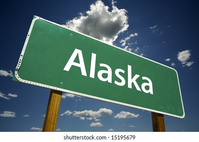 Alaska Road Sign with dramatic clouds and sky.