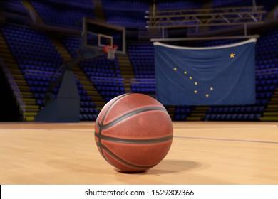 Alaska state flag and basketball on Court Floor