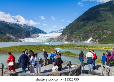 ALASKA, USA - JULY 23, 2013: Unidentified tourists at the view point of Mendenhall Glacier and Lake in Juneau, Alaska, USA