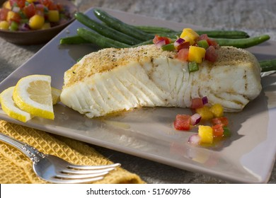 Alaskan Halibut on Dinner Plate with Green Beans and Lemon Slices